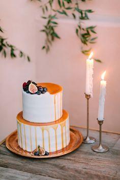 dripping wedding cake - photo by Julie Wilhite http://ruffledblog.com/european-inspired-jewel-toned-wedding-ideas