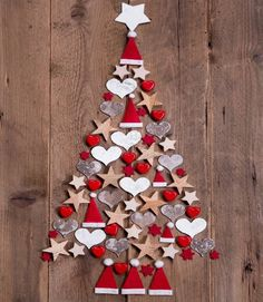 1x2's to make Christmas tree with felt ornaments and small wooden stars.