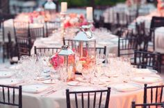peach/pink/cream color tables with low centerpieces and brown chivari chairs