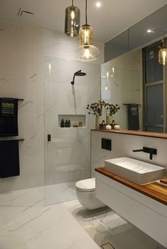 Modern bathrooms create a simplistic and clean feeling. In order to design your bathroom ideas make sure to utilize geometric shapes and patterns, clean lines, minimal colors and mid-century furniture. Your bathroom can effortlessly become a modern sanctuary for cleanliness and comfort. #contemporarybathrooms #midcenturyfurniture #modernbathroomdesign
