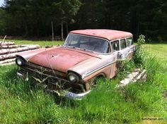 Great Ford Stationwagon in Washington. Needs a little restoration or a lot of restoration. About a 1956?