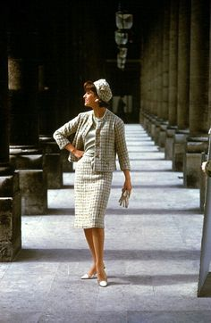 Model is wearing Chanel's complete ensemble, skirt, blouse, jacket with matching lining and small hat also in the same material, 1960