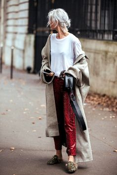 White t-shirt, trench coat, red printed snakeskin trousers and Gucci loafers fall outfit