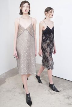 Sharon Wauchob - vintage looking shift dresses. Cream/beige and black lace. Mix of sheer and lace.