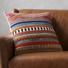 """Shop cusco 16"""" pillow.   Inspired by our love of Peruvian textiles, this multi-pattern pillow stitches together a traditional pattern in warm earthy tones on a field of soft wool and cotton.  Brings a traveled vibe to any space.  Reverses to solid ivory."""