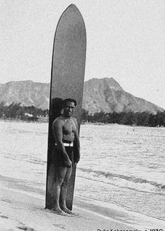 Duke learnt to surf on these huge long boards, riding waves with a grace and ...