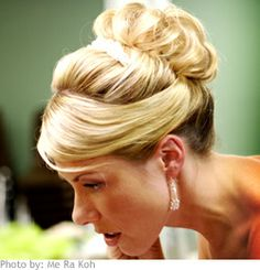 For a refined evening look, this bride chose to have her hair swept up into a pretty updo of pinned curls.