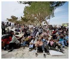 Refugees from Libya rest in Ras Ajdir, a coastal town on the border between Libya and Tunisia in March, 2011.