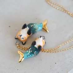 Purrmaid? Meomaid? Mercat? Whatever you call it, it's obviously majestic.  Pendant is hand-formed in ceramic, glazed in bright, glossy colors, and embellished w