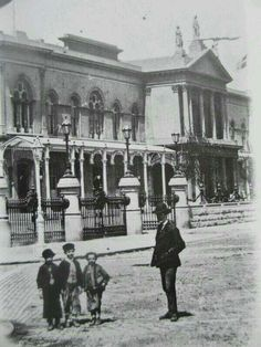 Man and children outside the Exhibition Palace and Winter Garden, Earlsfort Terrace. This building was specially constructed for the International Exhibition of Arts and Manufactures that opened in Dublin on 9 May 1865. The buildings were later adapted by tenants, University College Dublin (UCD), in 1908 and in 1918, the present façade to Earlsfort Terrace was altered.  It is now the National Concert Orchestra. Vintage Pictures, Old Pictures, Old Photos, Ireland Pictures, Images Of Ireland, University College Dublin, Dublin Street, Photo Engraving, Ireland Homes
