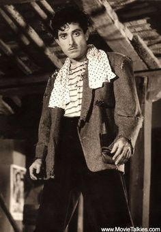 """Rajkumar as Kalu Villain in film Ujala 1959.Ujala (Ujala means Light in Hindi) is a Bollywood movie released in 1959, starring Shammi Kapoor, Mala Sinha, Raaj Kumar, Leela Chitnis and Tun Tun. Naresh Saigal was the story writer as well as the director of the movie. Ujala features one of the popular Bollywood songs """"Jhoomta Masoom, Mast Mahina"""" played by Shammi Kapoor and Mala Sinha, sung by Manna Dey and Lata Mangeshkar. The film came with a message; """"Honesty always triumphs"""" Bollywood Couples, Bollywood Songs, Bollywood Actors, Raaj Kumar, Shammi Kapoor, Rajesh Khanna, Lata Mangeshkar, Indian Star, Story Writer"""
