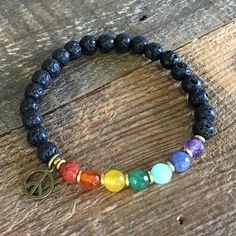Carry the power of essential oils with you, with this super cool chakra bracelet. Each gemstones is linked to a chakra, to help align and balance your energies, paired with lava stone, so that by adding a few drops of your favorite oil, you may also benefit from the healing power of essential oils!  #aromatherapy