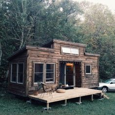 Natalie's Tiny House on Wheels by Nanostead - exterior - photos : tinyhousetalk #2 --- warm, cozy, inviting interior.
