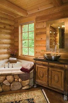 Log Cabin Bath... Love the stone around the tub!