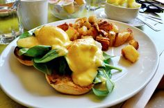 Poached Eggs Florentine ($8.95) from Sunnyside Grill (Corso Italia) located at 1218 St Clair Ave West