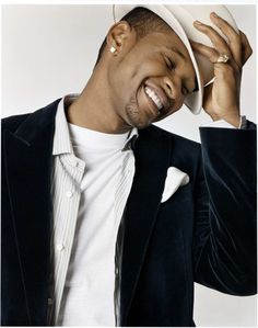 Usher.. I mean, Just look at those dimples! I wouldn't mind having that wonderful face around to admire 24/7.
