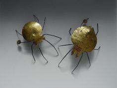 "Jura Golub - Brooches ""Spiders"" - Titanium, Stainless Steel, Gold, Glass Beads (Keum Boo, PUK welding) #titanium #gold #keumboo #juragolub #stainlessteel #handmade #unique"