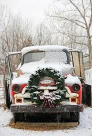 french country christmas decorations - I liked this holiday décor I spotted on pinterest - so I did the same thing & put a giant wreath on one of our older farm grain trucks - the farmer was happy !
