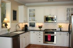 This is my dream kitchen...white subway tile backsplash. White cabinets. Dark countertop. Heaven...