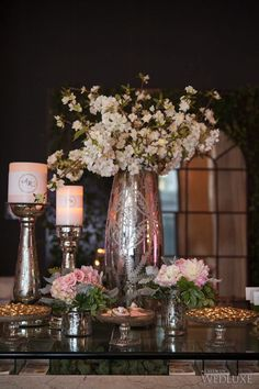Pastel #floral arrangements in Mercury glass vases   Photography by Amsis Photography   WedLuxe Magazine