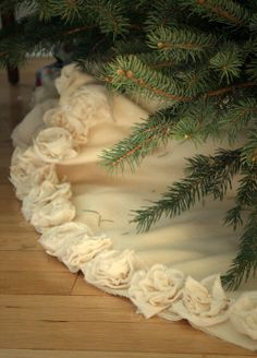 LOVE this Christmas tree skirt. Raw edges with hand ruched flowers on the edge.