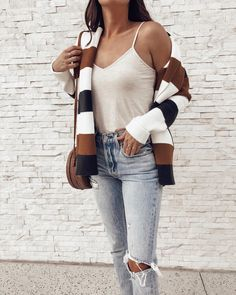"""1,054 Likes, 24 Comments - Tyler (@girlmeetsgold) on Instagram: """"Feeling fall-ready over here. 🍁🍂I've been on quite a cardigan kick and this one from @vicidolls is…""""    Vici dolls style, vici babe, vici style, fall fashion, fall style, fall cardigans, cognac cardigan outfit, striped cardigan outfit, levis style, jeans and cardigan outfit, womens outfit ideas for fall, cute fall looks"""