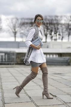 amazing outfit idea   grey clutch fur vest skirt white long shirt over knee  boots 621148334