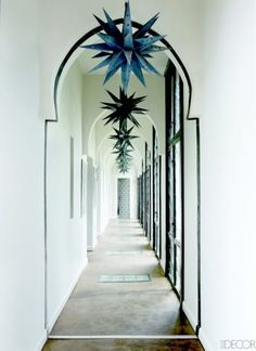 The light Morrocan hallway: polished cement, crisp white walls and light wells, Peacock Pavillions, Marrakesh, Morocco.