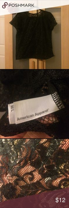American Apparel black lace top Size M/L. Black lace material top with scoop neck. Slight imperfection on bottom left hem (see additional pictures for detail). Please ask if you have any questions. Thank you! American Apparel Tops Blouses