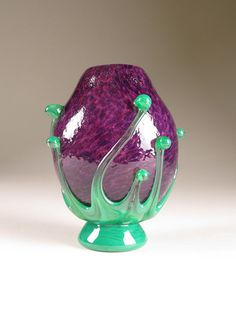 """Hand blown rosebud shaped glass vase by Dean Wolf of Austin, Texas. The foot is signed """"Wolf Art Glass 2011.""""  It stands 5.25"""" tall and is 4.25"""" at its widest point."""
