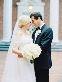 All white lush blooms from Tre Bella Florist wedding bouquet: http://www.stylemepretty.com/north-carolina-weddings/chapel-hill-north-carolina/2016/08/08/they-buried-a-bottle-of-bourbon-to-keep-the-rain-away-and-it-worked/ Photography: Nancy Ray - http://nancyrayphotography.com/