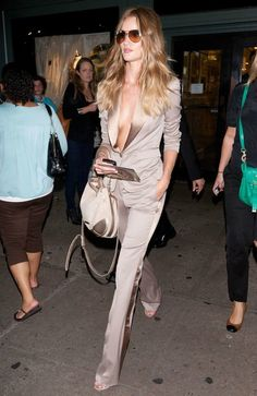 Champagne colored plunge suit on Rosie Huntington-Whiteley.