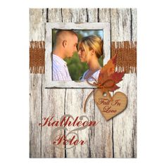 """If you are having a simple rustic country autumn wedding, then why not carry the look right over onto your wedding invitations or engagement announcement? This truly gorgeous shabby chic, rustic wood grain, old barn wood look PHOTO wedding invitation has a PRINTED burlap strip with a PRINTED FAUX cardboard cut-out heart with an orange bow tied on it with the stylized words """"Fall In Love"""" on it. There is a pair of dried fall leaves on the front and a pair of washed out maple leaves on the ..."""