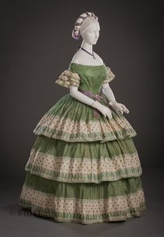 Evening Dress ca.1855-60. I like the color/pattern combinations of the fabric. I can see this combination in a bustle dress design.