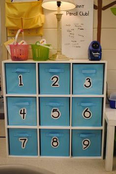 Station bins ... Blue for math purple for reading/LA with numbers around the room to match