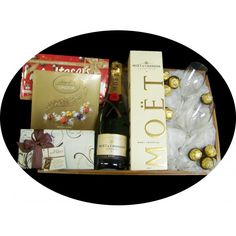 Gift Basket includes - 	Moet & Chandon Champagne 	Maltesers 	Wild Gourmet Chocolate Assortment 	Ferrero rochere chocolates 	Lindt Lindor Chocolate Assortment 	250ml wine glasses Presented in a gift wrapped tray $149.95 #chocolate #basket #champagne www.astylsihcelebration.com.au