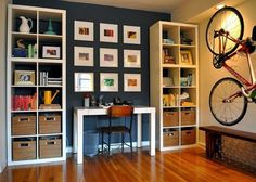 Cool idea for an office that would only take up one wall of a room. Desk between 2 IKEA shelves. Art above desk.