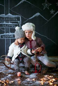 such a cute photo shoot : fake snow, lights and chalkboard background