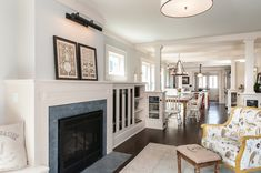 JAS Design Build renovated this historic home with comfort and practicality in mind. Craftsman Style Exterior, Craftsman Remodel, Moulding And Millwork, Living Spaces, Living Room, Built In Shelves, Historic Homes, Old Houses, Home Remodeling