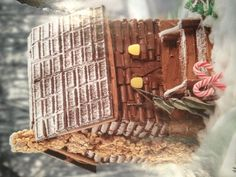 Gingerbread house idea...love the tootsie roll log cabin and chocolate bar shingles