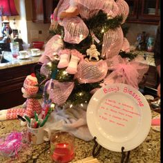 Decorate a Christmas tree with baby ideas for a baby shower