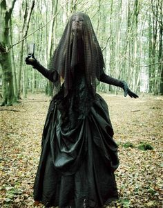 Dress up as the Woman in Black for Halloween.