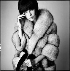 David Bailey, Leslie Caron, 1965. I love how rich and textured the fur looks in this shot.
