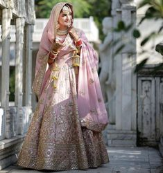 Pretty Pink wedding lehenga with golden hand embroidered on it.get this lehenga outfit from nivetas design studio. Contact us on… Golden Bridal Lehenga, Indian Bridal Lehenga, Pakistani Bridal Dresses, Indian Dresses, Punjabi Wedding, Punjabi Bride, Sikh Wedding, Wedding Wear, Wedding Lehanga