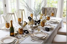 interior-marvelous-white-new-years-eve-party-tablescape-decorations-with-gold-champagne-glass-and-silver-candle-holder-also-gold-glittering-and-black-mask-on-glass-vase-b