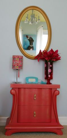 dated bedside table is now curvy and custom with a coat of pink spray paint!