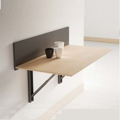 Wall mounted table provides a clean and modern look to any room. A folding wall mounted table can be a useful space saver