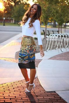 Can i just have this entire outfit?! love the patterns of the pencil skirt, with the simple white top and heels...and the perfect hair to top it off!