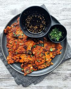 A savory, thin pancake loaded with kimchi and fried to crispy perfection in a cast iron pan. Good as an appetizer. Even better as a late night snack. #kimchi #kimchipancake #kimchijeon #kimchijun #koreanfood #kimchirecipe #leftoverkimchi #snack #latenightsnack #appetizer