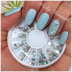 Clear Chrystal Rhinestones on Baby Blue Gel Polish nails.